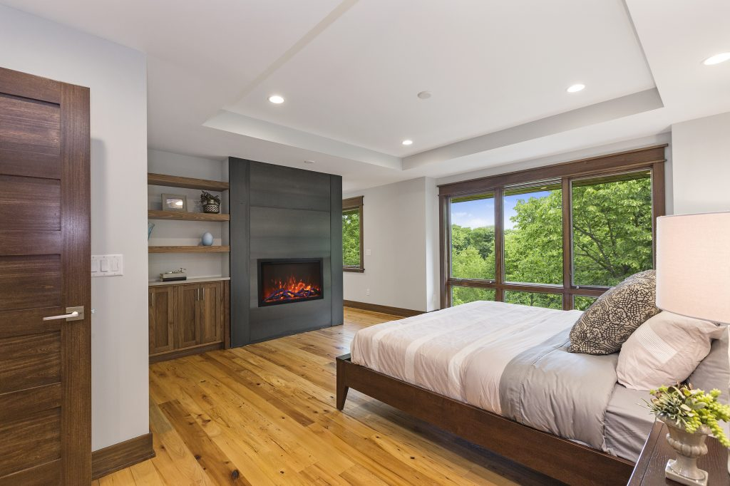 TRD Bespoke WiFi operated electric fireplace in a bedroom